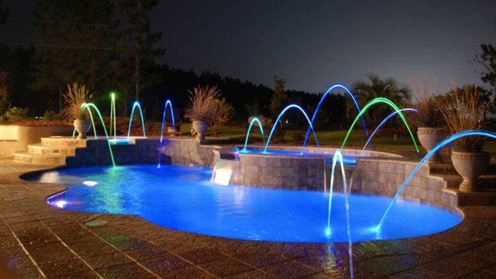 Enjoy life with your Trilogy Pool from Knickerbocker Pools and Spas — with fun lighting.